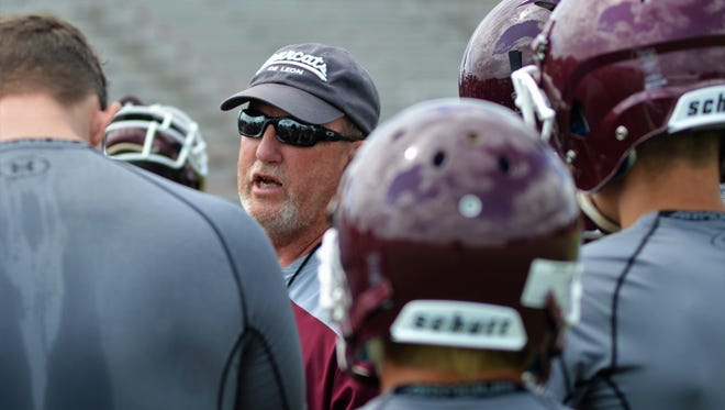 De Leon coach David Yeager speaks with his players before Tuesday's practice at Bearcat Stadium in De Leon.