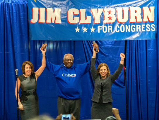 Rep. Jim Clyburn is flanked by House Minority Leader