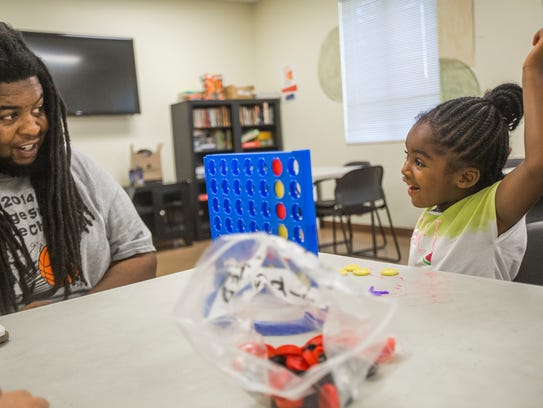 Stephen Williams plays games with his 4-year-old daughter,