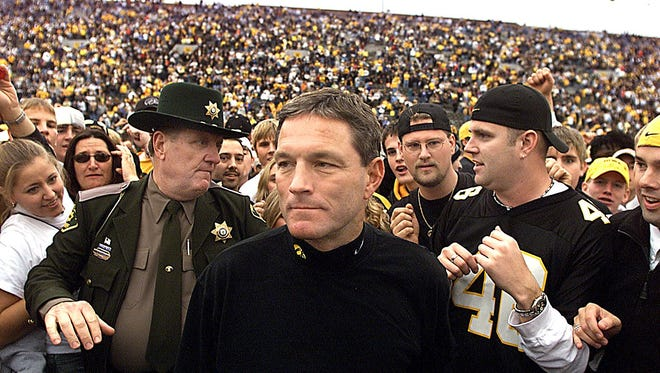 The man who escorted Hayden Fry and Kirk Ferentz on jogs to and from the Iowa football locker room for the better part of three decades is passing the coach-watching torch. Ron Stewart, pictured at back left, a retired Polk County deputy sheriff, is ceding his duties to Iowa Campus Police Lt. Peter Berkson.