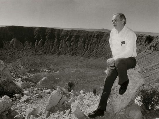 Eugene Shoemaker sits on the edge of Meteor Crater.