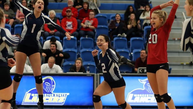 Jessica DeMarco, Jordan Stec and Hannah Murphy celebrate a point during the fourth set to give Rockland the 16-13 lead over Frontier in the Division 3 state final at Worcester State University on Saturday, Nov. 16, 2019.