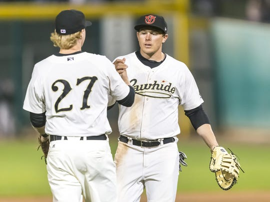 Visalia Rawhide infielder Marty Herum, left, and Austin