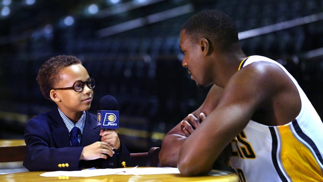 Coleman Reynolds, 7, Indianapolis, an Amy Beverland Elementary School student, interviewed a bulked-up  Ian Mahinmi during Pacers Media Day on Monday at Bankers Life Fieldhouse.