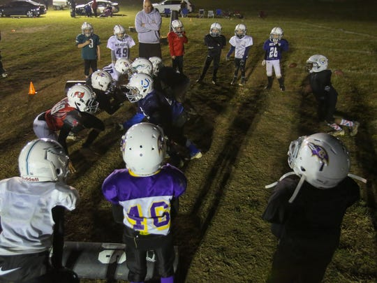 Players take part in youth football practices at the