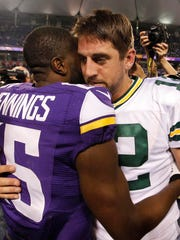 Aaron Rodgers and old teammate Greg Jennings greet each other after the Packers' victory in their last game in the Metrodome.