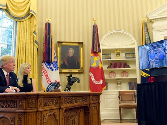 President Donald Trump, accompanied by his daughter Ivanka Trump, talks via video conference with International Space Station Commander Peggy Whitson and Jack Fischer on the Space Station, Monday, April 24, 2017, from the Oval Office of the White House in Washington.