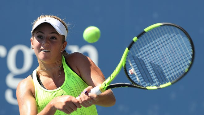 CiCi Bellis hits a return to Viktorija Golubic of Switzerland during their match at the US Open Tennis Championship at the USTA National Tennis Center on Aug. 29.