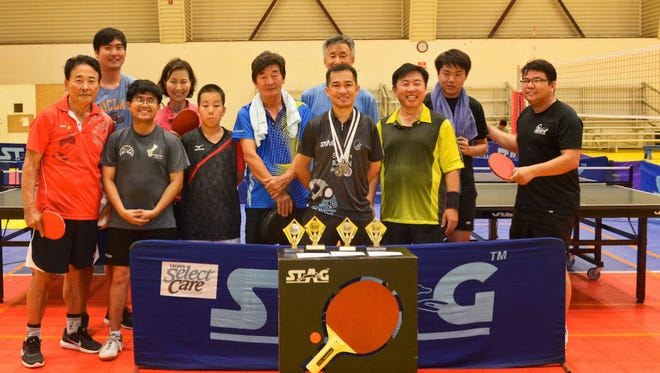 Players pose for a photo during the Guam Table Tennis Association's annual Holiday Tournament at the Dededo Sports Complex on Dec. 20.