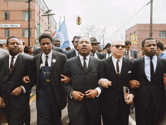 This famous photo is often identified as Martin Luther King Jr. leading the march from Selma to Montgomery, but it is actually from the student protests in Montgomery days before the march. Members of the SCLC, including King, the Rev. Ralph Abernathy and the Rev. Jesse Douglas, join SNCC executive director James Forman and John Lewis in a show of support for the students.