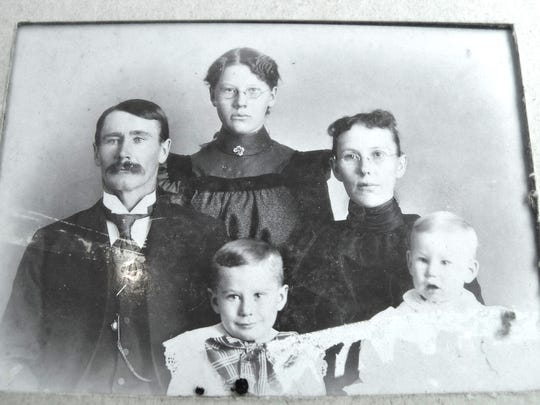 Joe Burwell's ancestors; great-grandfather John, his daughter Nettie Grace, John's wife- also Nettie Grace and front from left: John's sons Robert and Donald. Donald Burwell is Joe's grandfather. Burwell's farm was named a Bicentennial Farm by the Ohio Department of Agriculture.