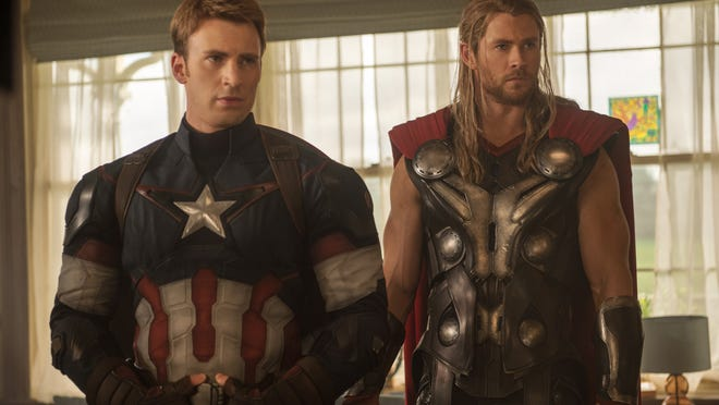 """Chris Evans, as Captain America/Steve Rogers, and Chris Hemsworth, as Thor, appear in the new film """"Avengers: Age Of Ultron."""""""