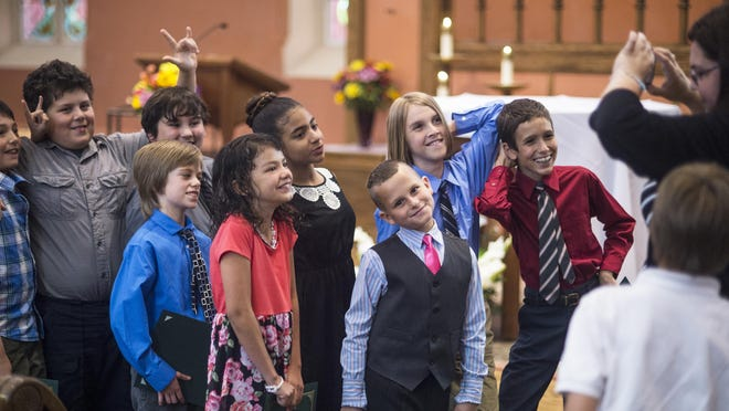 Members of the St. Patrick School 2015 fifth-grade graduating class pose for a photo after a graduation ceremony inside St. Patrick Church in Owego on Tuesday evening.
