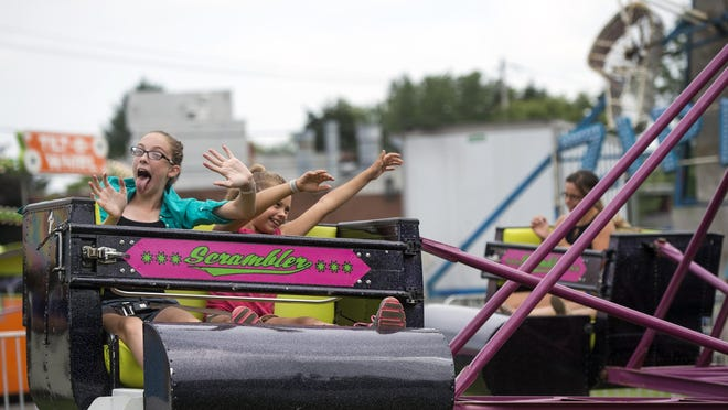 Amyra Goldenberg, 12, of Owego, left, and Hailey Engbith, 8, of North Valley, ride the Scrambler at the Tioga County Fair in 2015.