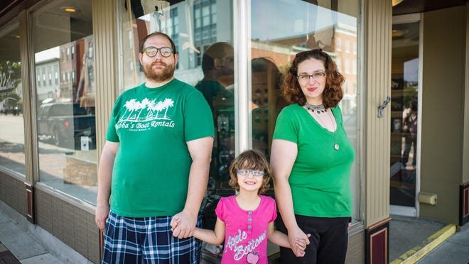 "Jim Hanson, wife Jacque, and daughter Sammy, 5, enjoy a nice day in Lebanon, Ohio on Saturday July 18, 2015. Jacque and Jim are Polyamorous and her ""other better half"", lives in Louisville."