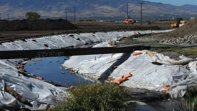 A stream is diverted for phase two of the southeast connector road construction project in the Reno/Sparks area on Oct. 14, 2015.