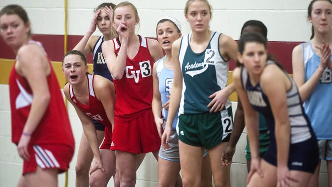 Runners cheer their teammates about to receive the first handoff during the Division I girls 4x200-meter relay in last year's state championships at Norwich University.