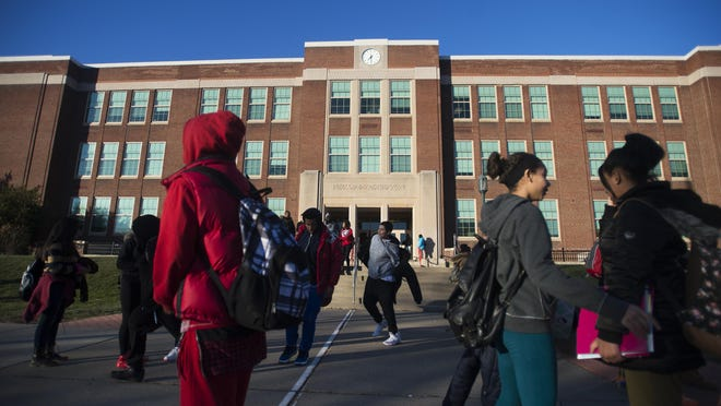 Students leave East Middle School at the end of a recent school day.