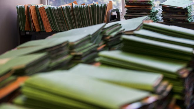 Stacks of drug court cases are shown on Friday in Montgomery, Ala.