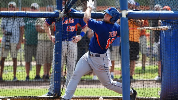 Tim Tebow watches the ball sail into the outfield Monday,