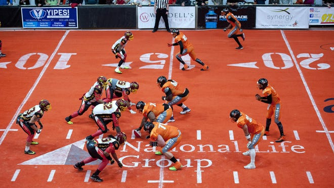 The Vermont Bucks get set before a snap against the Connecticut Chiefs during Friday night's indoor football game at Gutterson Fieldhouse. Vermont won its inaugural game 73-21.