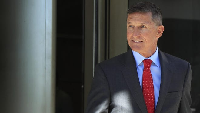 In this Tuesday, July 10, 2018 file photo, former Trump national security adviser Michael Flynn leaves federal courthouse in Washington, following a status hearing. Flynn is relaxed and hopeful even as the possibility of prison looms when he's sentenced in the Russia probe Tuesday, Dec. 18, 2018. The retired three-star general pleaded guilty last year to lying to the FBI about conversations he had with the then-Russian ambassador to the U.S. during President Donald Trump's White House transition.