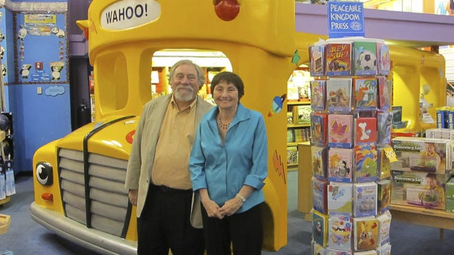 """This handout photo provided by Scholastic shows author Joanna Cole, right, and illustrator Bruce Degen. Cole, whose """"Magic School Bus"""" books transported millions of young people on extraordinary and educational adventures, has died at age 75. With the ever maddening but inspired Ms. Frizzle, based in part on a teacher Cole had growing up, leading her students on journeys that explored everything from the solar system to underwater, """"Magic School Bus"""" books have sold tens of millions of copies and were the basis for a popular animated TV series and a Netflix series. Plans for a live-action movie with Elizabeth Banks as Ms. Frizzle were recently announced."""