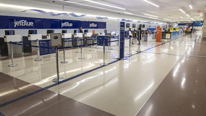 There were few passengers in the ticketing area at  Palm Beach International Airport Thursday morning, March 13, 2020.