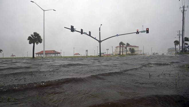 A storm surge covers U.S. 90 in Long Beach, Miss., on the Mississippi Gulf Coast as Tropical Storm Cristobal makes landfall Sunday, June 7.