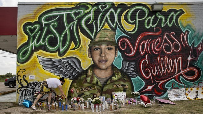 Veronica Carbajal places a candle at a mural for Army Spc. Vanessa Guillen in Southeast Austin.