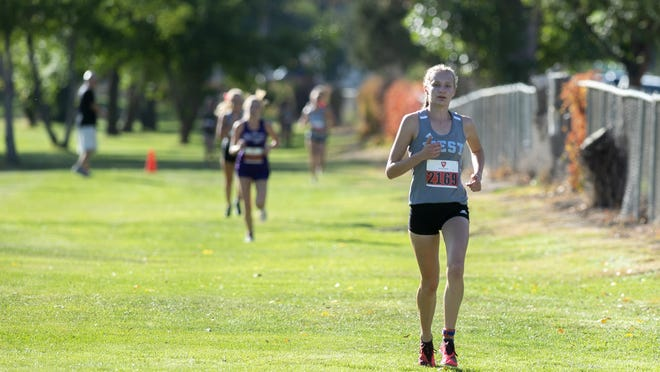 Aspen Fulbright establishes her lead against the other racers during the Pueblo City-County cross-country meet last October.