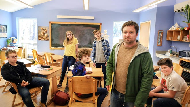 Seacoast Waldorf School teacher Dennis Drennan is seen with an eighth-grade class at the school in March 2019. Seacoast Waldorf School announced it will offer classroom education this year with many pandemic-related safeguards.