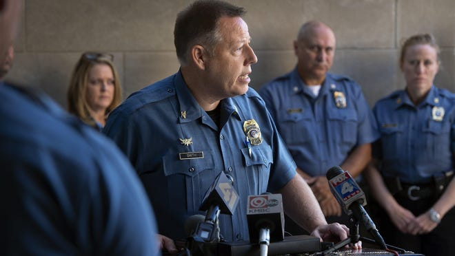 Kansas City Police Chief Rick Smith calls for community members to come forward with tips following a string of violent crime in 2018. Smith said this week that proposed budget cuts in Kansas City would 'devastate' his department.