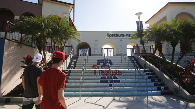 In this file photo, a couple of fans appear outside Spectrum Field, the Phillies' spring training stadium in Clearwater, Fla.