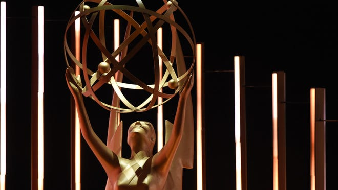 The Emmy statuette, depicting a winged woman holding an atom.