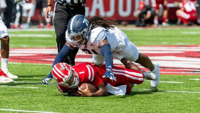 Georgia Southern's Zyon McGee tackles Louisiana quarterback Levi Lewis on Saturday at Cajun Field in Lafayette, Louisiana. [SCOTT CLAUSE/LAFAYETTE DAILY ADVERTISER].