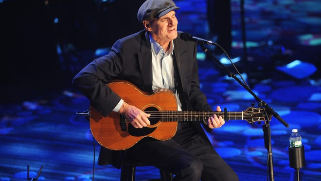 ""\Musician James Taylor performs at the 2014 Toys """"R"""" Us Children's Fund Gala at the New York Marriott Marquis on May 15, 2014 in New York City.""660|372|?|en|2|c27757f4dad19733c98bb404d9fd5b83|False|UNLIKELY|0.37815532088279724