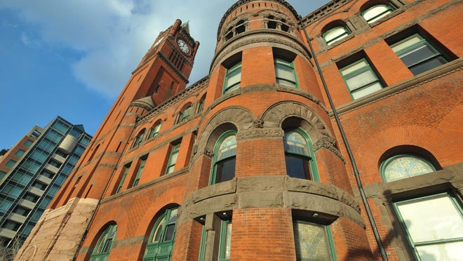 Indianapolis'  Union Station is a 3 1/2 -story Romanesque Revival structure, built of brick, granite and sandstone and featuring a 185-foot clock tower.