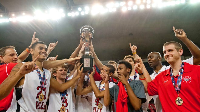 The Ville celebrates its 11th-grade AAU national championship in Freedom Hall on Monday night. Trinity High big man Raymond Spalding scored 15 points in The Ville's 46-40 victory over the Albany (N.Y.) City Rocks.