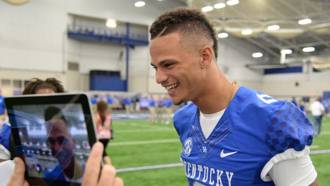 Freshman wide receiver Blake Bone gets interviewed during the Cats' media day earlier this month.