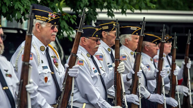 The Stanford honor guard stands at attention, Thursday May 22, 2014, at the Veterans Memorial Garden at Preston Pruitt Funeral Hone in Danville, Ky. (AP Photo/The Advocate-Messenger, Clay Jackson) TABLOIDS OUT.