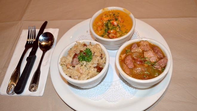 Baby'sKay's popular combination with (clockwise from left) Chicken and sausage jambalaya, crawfish etouffee, and chicken and sausage gumbo.