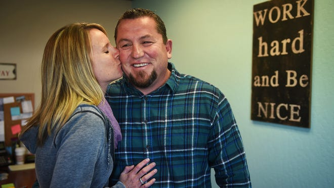 Citizen of the Year Randy Cunningham receives a kiss from his wife Christi while posing for a portrait in their office at their business Silver State Barricade & Sign in Reno on Dec. 31, 2014.