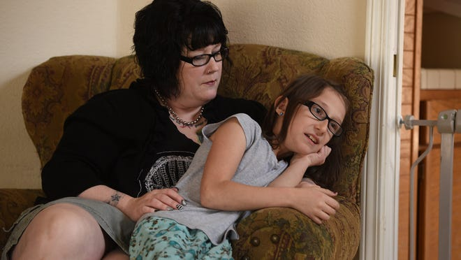 9-year-old Cee Cee Otton her mother Shanna's lap while being interviewed by the Reno Gazette-Journal at their home in Reno on Feb. 25, 2015.