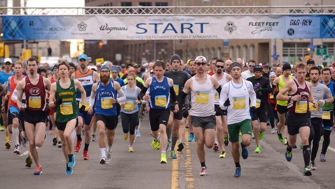 Racers begin the Flower City Half Marathon on the Broad Street bridge, Sunday, April 26, 2015.