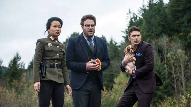 """Sony shows, from left, Diana Bang, as Sook, Seth Rogen, as Aaron, and James Franco, as Dave, in Columbia Pictures' """"The Interview."""" When a group claiming credit for the hacking of Sony Pictures Entertainment threated violence against theaters showing """"The Interview"""" earlier this week, the fate of the movie was all but sealed. Even though law enforcement didn't deem the threats of violence credible, theater owners and Sony undoubtedly considered the 2012 massacre of a dozen people in a Colorado movie theater. That attack came without warning, and there was no precedent for such mass violence against a U.S. movie audience."""