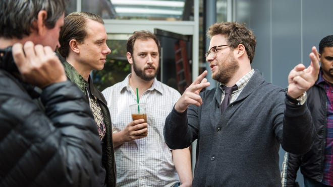 """This photo provided by Columbia Pictures - Sony shows, from left, 1st AD Jonathan Watson, DP Brandon Trost, Evan Goldberg and Seth Rogen on the set of Columbia Pictures' """"The Interview."""" The New York City premiere of the film has been canceled due to threats."""