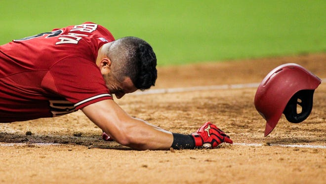 Arizona Diamondbacks batter David Peralta falls to the ground after being struck in the head by a pitch from Miami Marlins starting pitcher Jose Fernandez in the sixth inning at Chase Field in Phoenix, on Wednesday, July 22, 2015.
