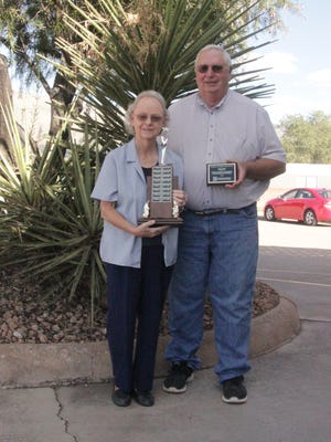 Alice Money, OCAER Volunteer Coordinator, holds the OCAER's trophy for most volunteer hours completed of all OCAER chapters in New Mexico.