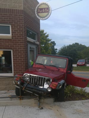 A two-vehicle crash Sunday evening sent this Jeep Wrangler sideways into the entrance of the Popp-a-Top tavern at 18th Street and Schuyler Avenue. The north-end Lafayette tavern reopened in August after being closed more than a year after a dump truck ran through it in June 2015.